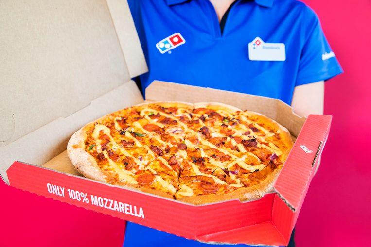 Uitbaters van Domino's Pizzarestaurants zijn verwikkeld in een escalerende strijd met het moederbedrijf, Domino's Pizza Nederland, dat zij beschuldigen van machtsmisbruik. Beeld Hollandse Hoogte / PA Images