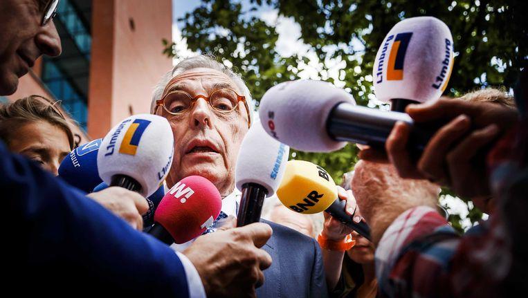 Jos van Rey staat de media te woord na het vonnis van de Rotterdamse rechtbank. Van Rey kreeg een werkstraf van 240 uur. Beeld ANP