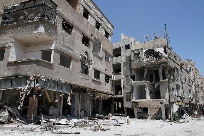 Een verwoeste woonwijk in Syrië.