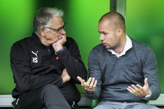 Trainer Danny Buijs van FC Groningen met assistent Hennie Spijkerman.