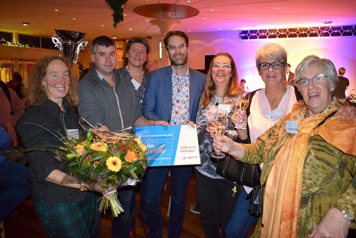 Peter Heijkoop tussen de winnaars van de Dordtse Vrijwilligersprijs 2019.