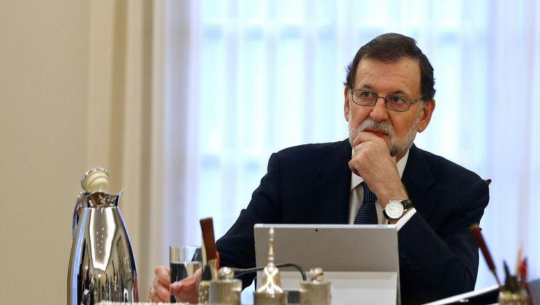 Rajoy zit de speciale ministerraad voor op woensdag 11 oktober Beeld ap