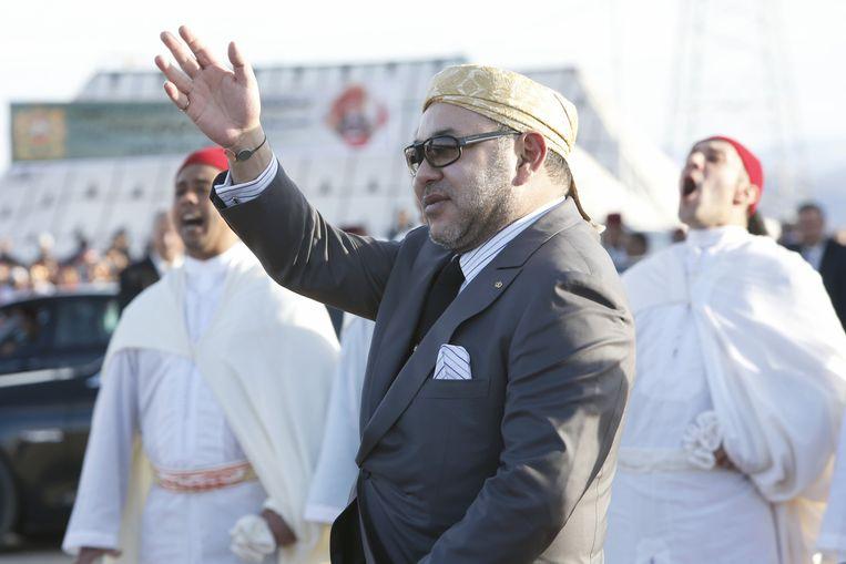 De opening van de zonnecentrale in Ouarzazate wordt luister bijgezet door koning Mohammed VI en musicerende bedoeïenen. Beeld null