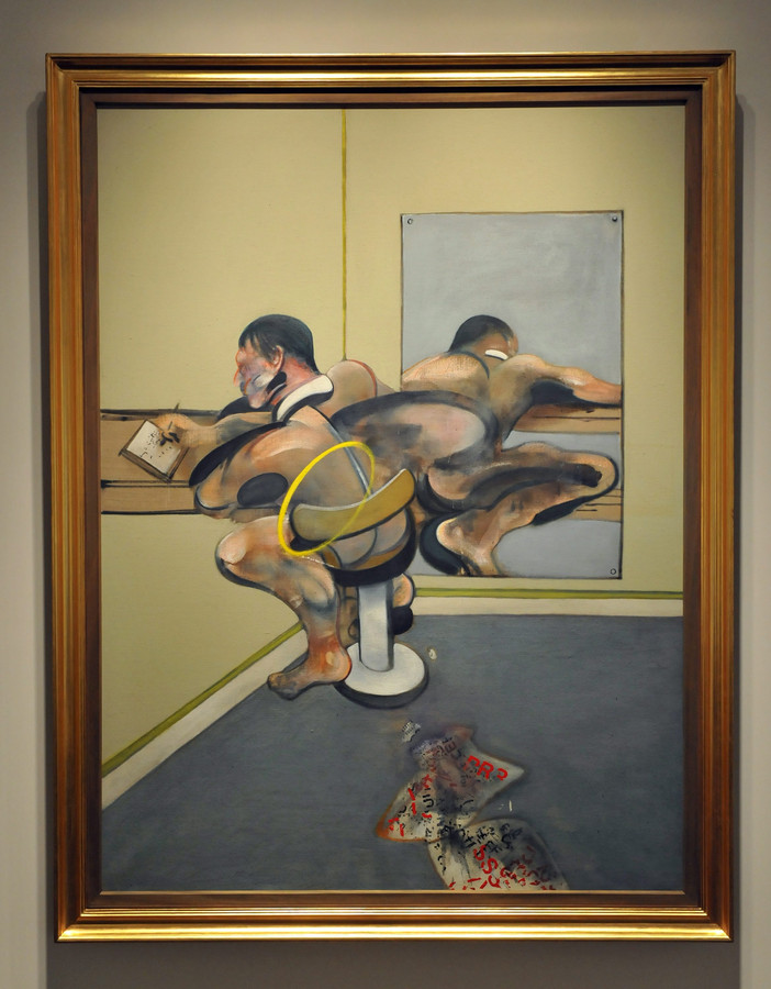 'Figure Writing Reflected in Mirror' van Francis Bacon.