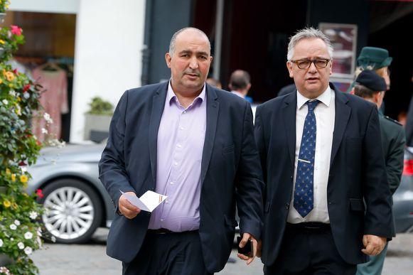 Fouad Ahidar (l) naast Armand De Decker.