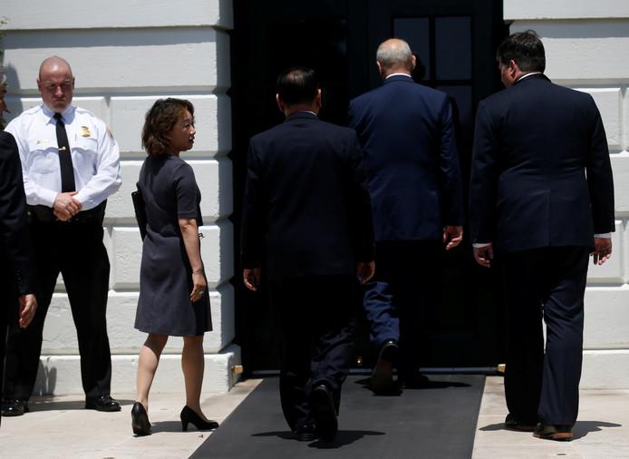Kim komt aan bij het Witte Huis