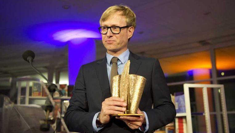 Peter Terrin met zijn prijs. Beeld anp