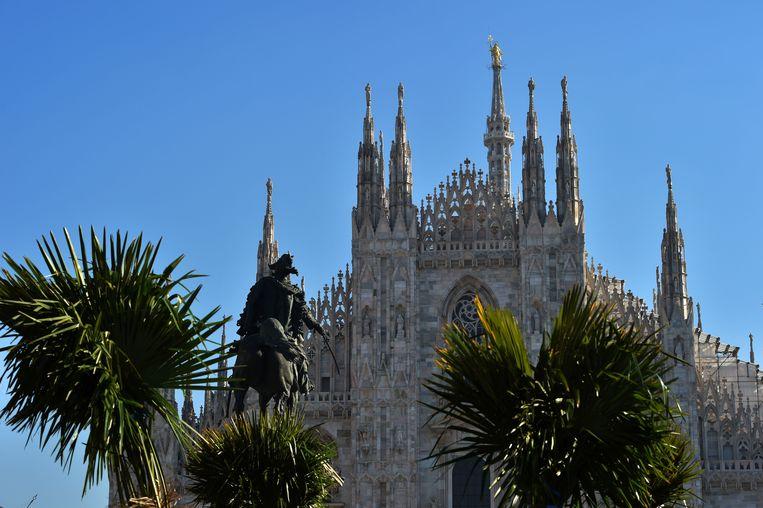 De palmen op het Piazza del Duomo in Milaan. Beeld AFP
