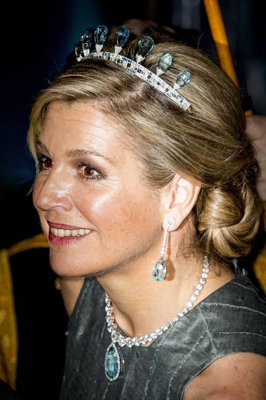 De koningin na het galadiner.