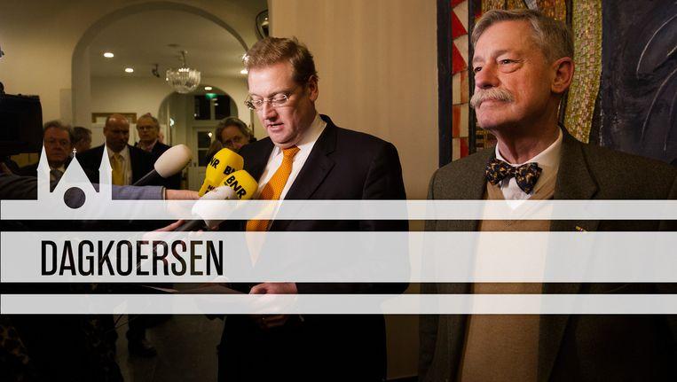 Minister Van der Steur naast professor Maat, die na stug doorzetten zijn gelijk haalde en excuses kreeg. Beeld ANP/de Volkskrant