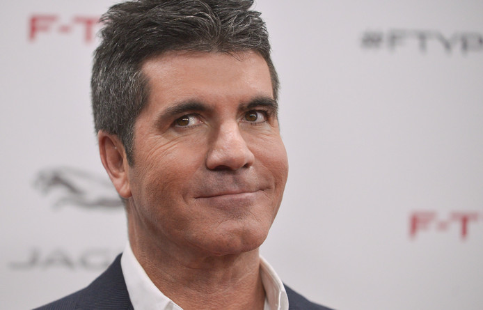 Simon Cowell is geen homo, zegt hij.