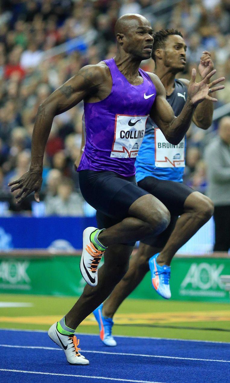 De 40-jarige Kim Collins uit Saint Kitts en Nevis op weg naar winst tijdens de 60 meter sprint op 13 februari 2016 in Berlijn. Beeld epa