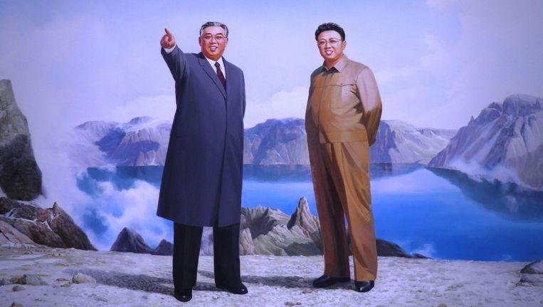 Op propagandaposters staan de Kims regelmatig afgebeeld bij het reusachtige kratermeer van Paektu. Beeld null