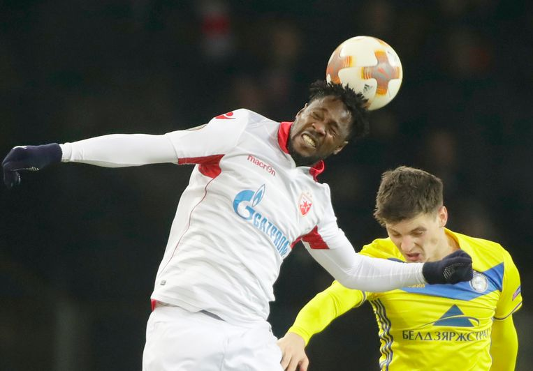 Red Star's Richmond Boakye, left, is airborne with BATE's Stanislav Dragun during the Europa League group H soccer match between Bate and Red Star Belgrade at the Borisov-Arena stadium in Borisov, Belarus, Thursday, Nov. 23, 2017. (AP Photo/Sergei Grits)