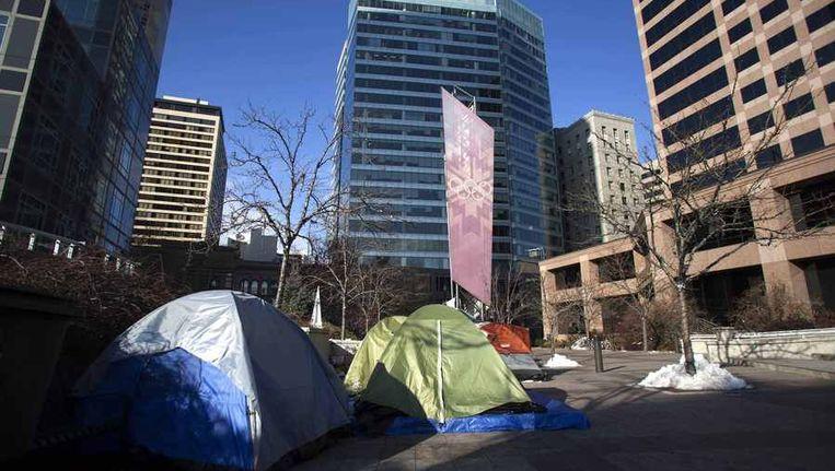 Occupy-demonstranten kamperen tegenover het kantoor van Goldman Sachs. Beeld reuters