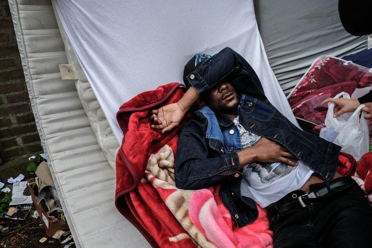 De uitgeprocedeerde asielzoekers van We Are Here moeten hun gekraakte woningen in de Amsterdamse Rudolf Dieselbuurt verlaten. Beeld Hollandse Hoogte