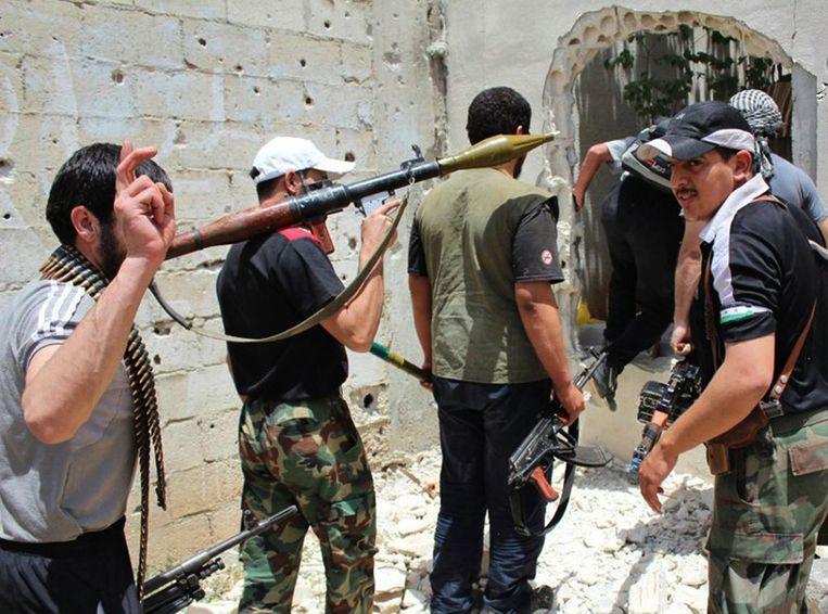 Anti-regeringsactivisten in Homs. Beeld ap
