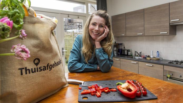 Marieke Hart van de website thuisafgehaald.nl. Inmiddels zijn er via de site 185.000 maaltijden verhandeld.