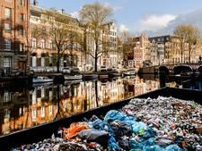 Proef: vuilnis Negen Straatjes via de gracht afgevoerd