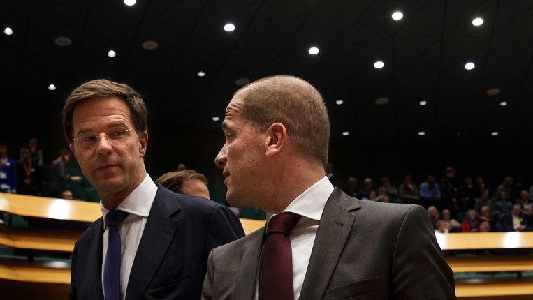 Premier Mark Rutte en PvdA-leider Diederik Samsom in de Tweede Kamer Beeld Nederlandse Freelancers