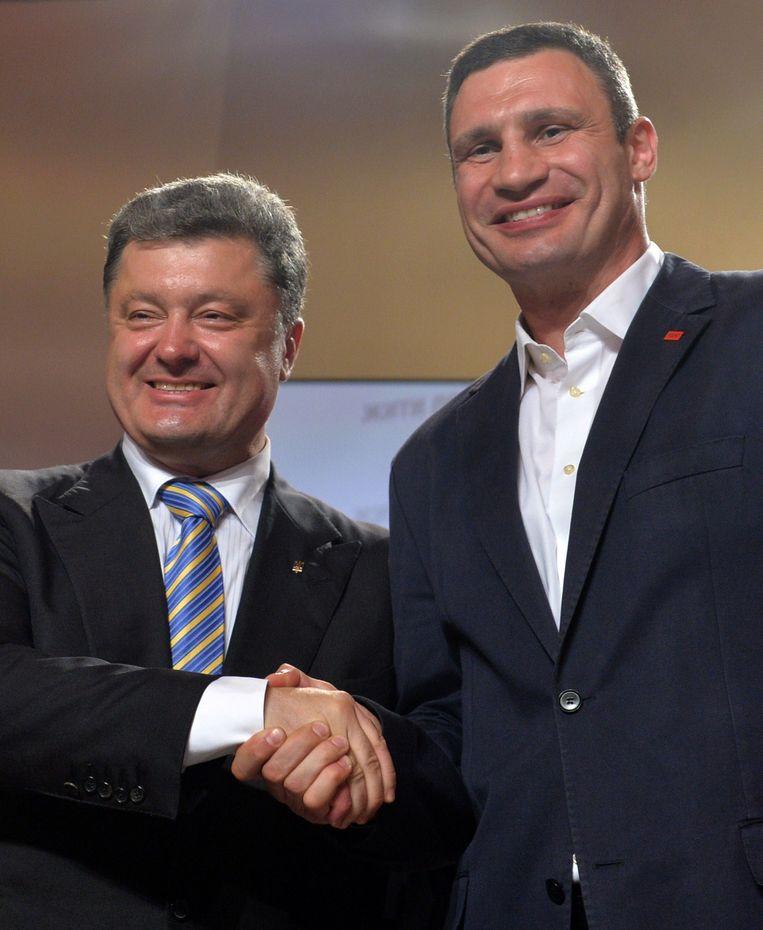 De twee winnaars van de Oekraïense verkiezingen presidentskandidaat Petro Porosjenko en de burgemeester van Kiev Vitali Klitsjko.