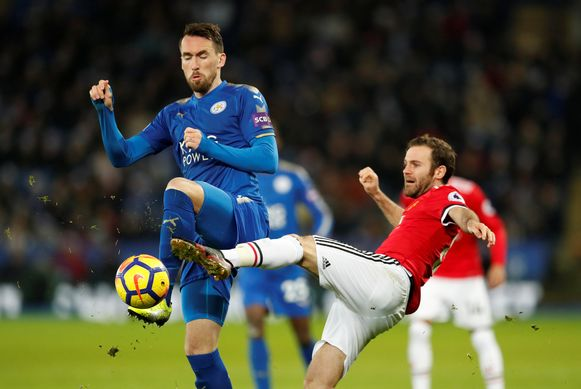 """Soccer Football - Premier League - Leicester City vs Manchester United - King Power Stadium, Leicester, Britain - December 23, 2017   Leicester City's Christian Fuchs in action with Manchester United's Juan Mata    Action Images via Reuters/Andrew Boyers    EDITORIAL USE ONLY. No use with unauthorized audio, video, data, fixture lists, club/league logos or """"live"""" services. Online in-match use limited to 75 images, no video emulation. No use in betting, games or single club/league/player publications.  Please contact your account representative for further details."""