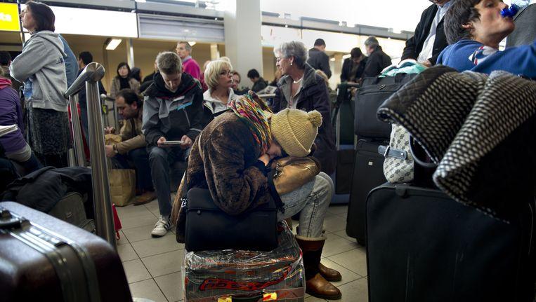 Gestrande passagiers op Schiphol. Beeld ANP