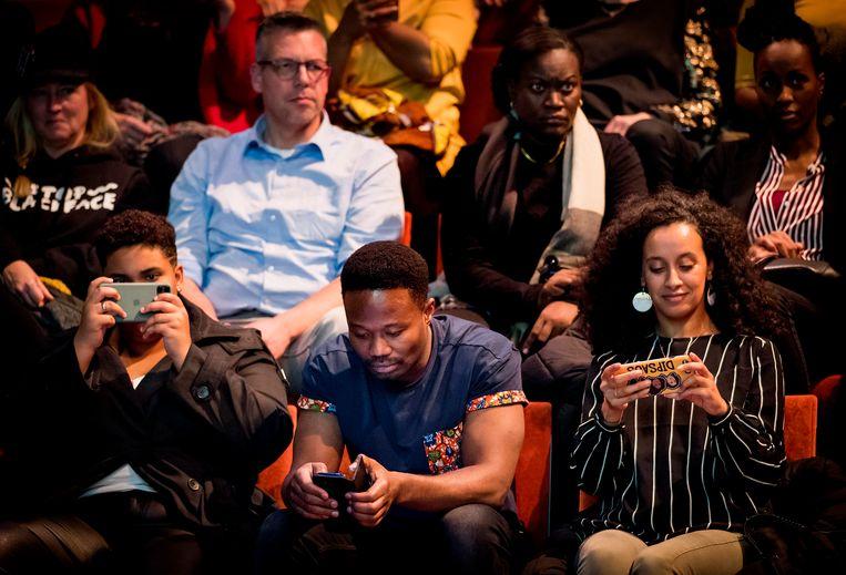 Voorman Jerry Afriyie van Kick Out Zwarte Piet tijdens een bijeenkomst op pakjesavond. Beeld ANP