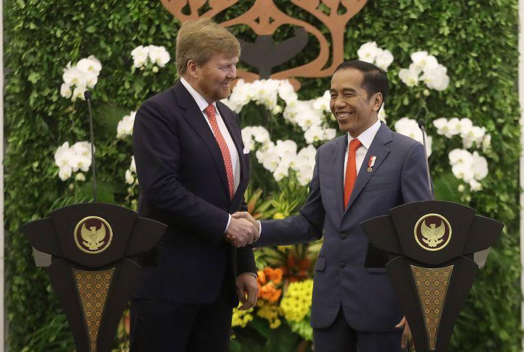 Indonesische president Joko Widodo (R) en koning Willem-Alexander. Beeld EPA