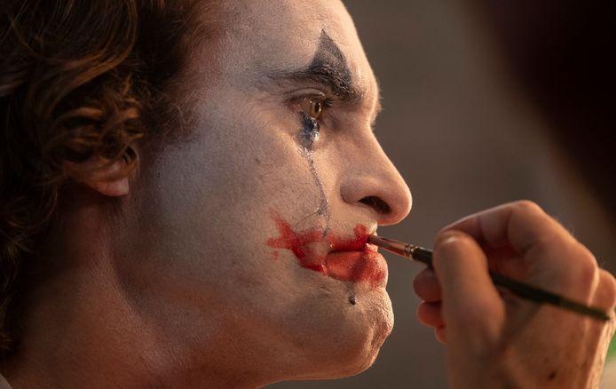 Joaquin Phoenix als The Joker.