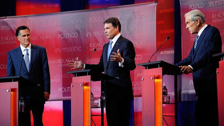 De Republikeinse kandidaten Mitt Romney (links), Rick Perry (midden) en Ron Paul (rechts). Beeld getty