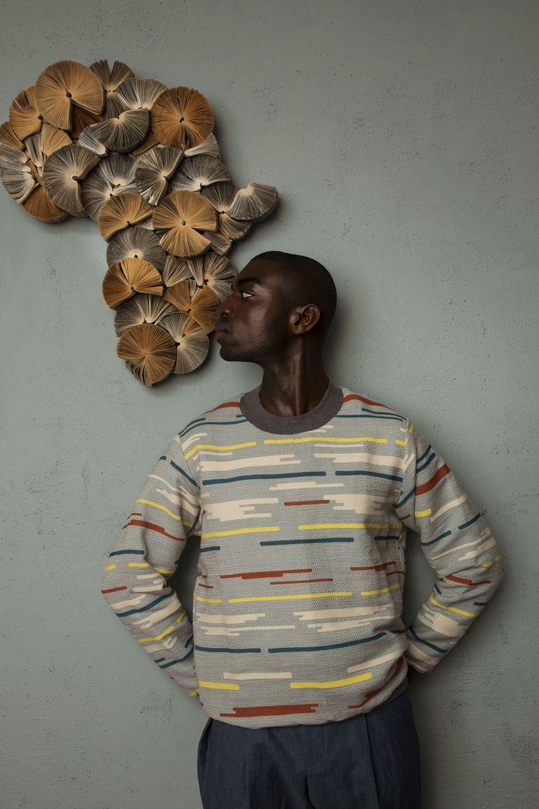 Model Kevin draagt een trui van NON by Kim. Broek is van Hugo Boss. Beeld Anne Dokter