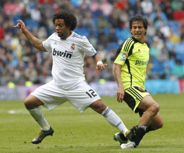 Marcelo (L) van Real Madrid staat op het been van Jorge Lopez (R). EPA Beeld