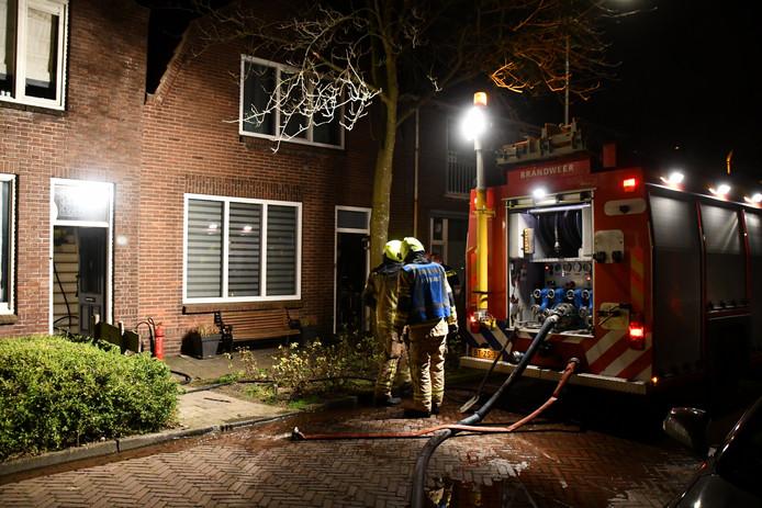 Brandweer bij het huis.