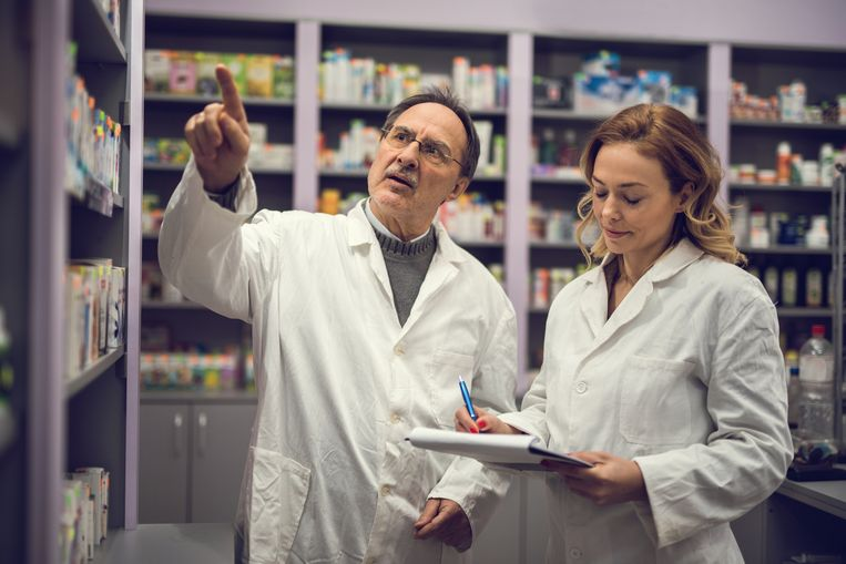Two pharmacist doing medicine checklist at the pharmacy