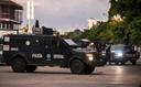 Mexicaanse staatspolitie in de straten van Culiacán na de arrestatie van een van de zoons van El Chapo.