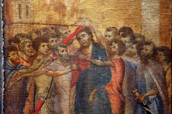Een detail van het schilderij 'De Bespotte Christus' van Cimabue dat voor een recordbedrag van 24 miljoen euro geveild is.