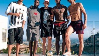 Fellaini en Januzaj broederlijk naast Franse international die België uitschakelde
