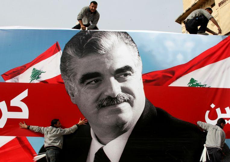 Een grote poster van de vermoorde oud-premier Rafik al-Hariri. Beeld Reuters