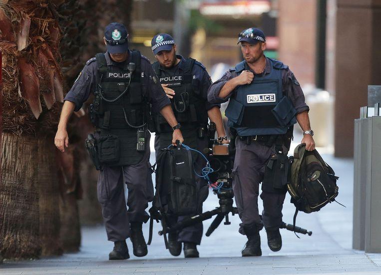 Politie in Philip Street, nabij het Lindt café. Beeld getty