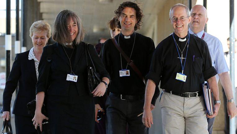 Blije gezichten bij onder anderen de Aartbisschop van Canterbury (rechts). Beeld afp
