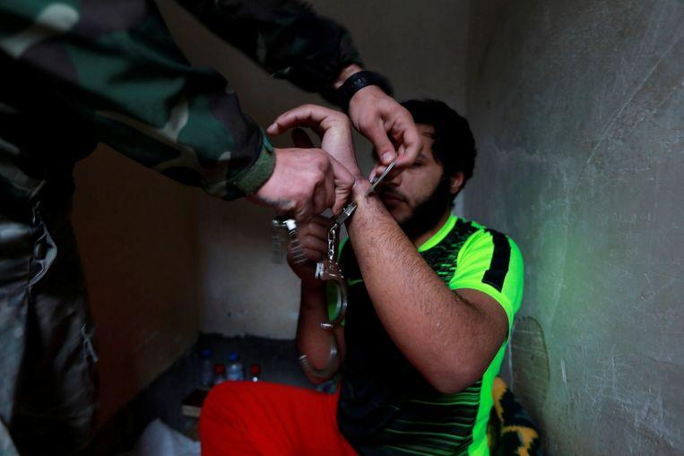 IS-strijders in de Iraakse gevangenis in Sulaimaniya. Beeld Reuters