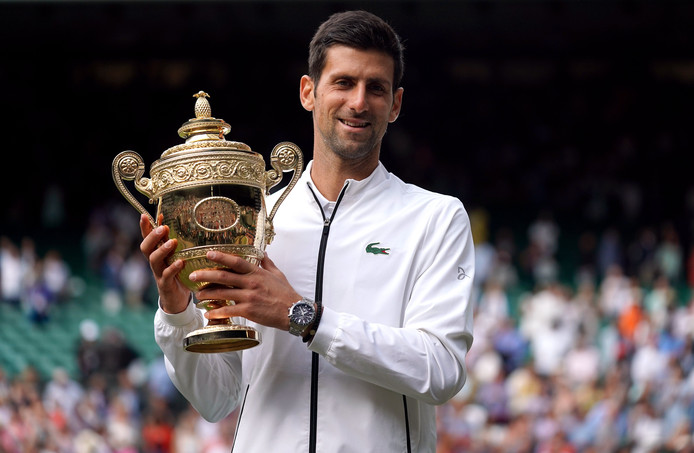 Novak Djokovic with the trophy after beating Roger Federer in the mens singles final on day thirteen of the Wimbledon Championships at the All England Lawn Tennis and Croquet Club, Wimbledon. ! only BELGIUM !