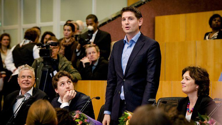 D66-lijsttrekker Jan Paternotte legt zijn eed af tijdens de installatie van nieuwe leden van de Amsterdamse gemeenteraad in maart. Beeld anp