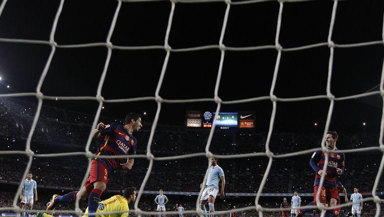 Luis Suarez en Lionel Messi na hun combinatiestrafschop. Beeld ap