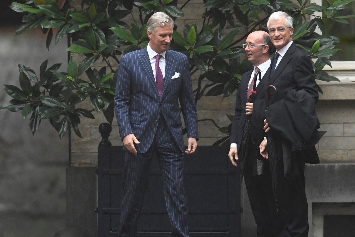 Bourgeois (r.) en Demotte (m.) brengen op 4 november verslag uit bij Koning Filip.