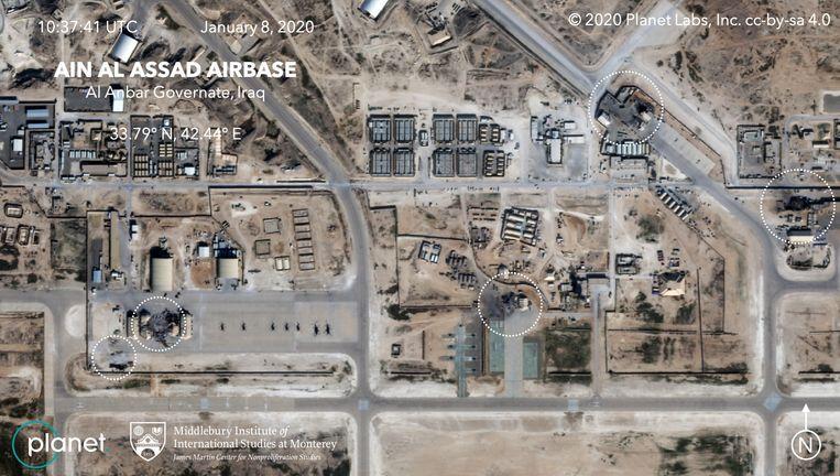 Op deze satellietbeelden zou de schade te zien zijn die de Iraanse raketaanval aanrichtte op de Iraaks-Amerikaanse basis Ain Assad. Beeld AFP