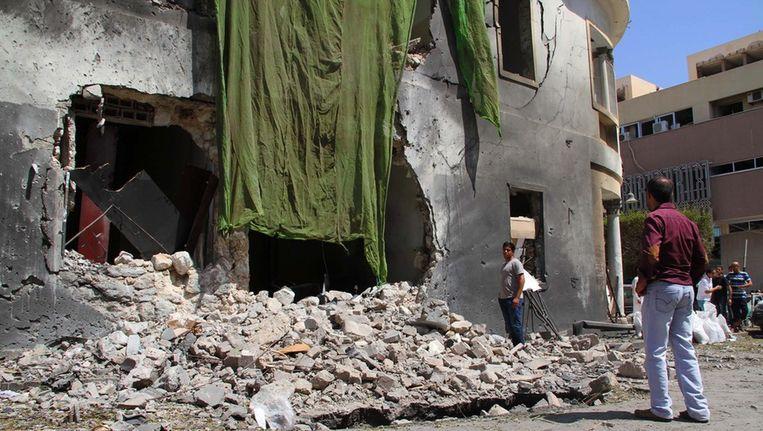 Ravage in Benghazi na een bomaanslag vorige week Beeld ANP