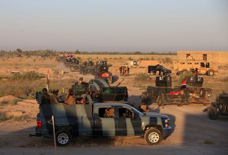 Iraakse soldaten in de buurt van Fallujah.