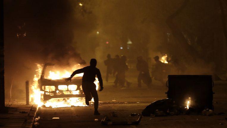 Demonstranten in het centrum van de Griekse hoofdstad Athene. Beeld ap